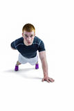 Muscular rugby player doing one hand push ups Royalty Free Stock Photography