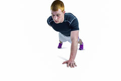 Muscular rugby player doing one hand push ups Royalty Free Stock Image