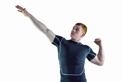 Muscular rugby player pointing to the sky Royalty Free Stock Images