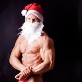 Muscular santa claus Stock Images