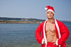 Muscular santa claus show. Muscular santa claus in summer holiday stock images