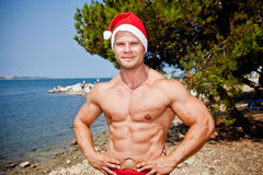 Muscular santa claus show Royalty Free Stock Photo