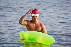 Muscular santa claus show Stock Photo