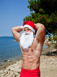 Muscular santa claus. In summer holiday royalty free stock photography