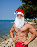Muscular santa claus. In summer holiday royalty free stock photo