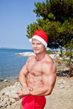 Muscular santa claus. In summer holiday stock images