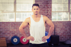 Muscular serious man facing the camera Royalty Free Stock Images