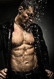 Muscular sexy guy. The very muscular handsome sexy guy under shower, naked  torso Stock Images
