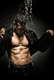Muscular sexy guy. The very muscular handsome sexy guy under shower, naked  torso Stock Photography