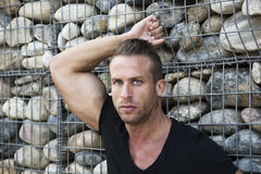 Muscular sexy man in front of stone wall Stock Photography