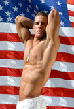 Muscular Sexy Man with US Flag behind Stock Image