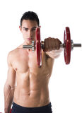 Muscular sexy shirtless young man exercising shoulders Royalty Free Stock Image