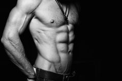Muscular and sexy torso of young man. Black and Stock Photography