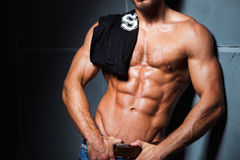 Muscular and sexy torso of young man in jeans Royalty Free Stock Image