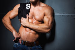 Muscular and sexy torso of young man in jeans Stock Photo