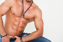 Muscular and sexy torso of young sporty man in Royalty Free Stock Photos
