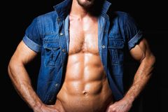 Muscular and sexy young man in jeans shirt with Royalty Free Stock Photo