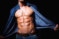 Muscular and sexy young man in jeans shirt with Stock Photos