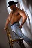 Muscular shirtless cowboy Stock Photos