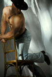 Muscular shirtless cowboy Stock Images