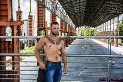 Muscular Shirtless Hunk Man Outdoor in City Stock Image