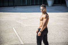 Muscular Shirtless Hunk Man Outdoor in City Setting Stock Photo