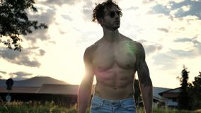 Muscular Shirtless Hunk Man Outdoor in Countryside. Handsome Muscular Shirtless Hunk Man Outdoor in Country Standing on Grass. Showing Healthy Muscle Body While Stock Images