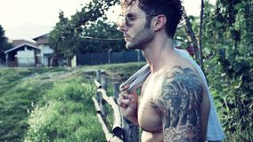 Muscular Shirtless Hunk Man Outdoor in Countryside. Handsome Muscular Shirtless Hunk Man Outdoor in Country Standing on Grass. Showing Healthy Muscle Body While royalty free stock photo