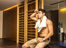 Muscular shirtless male athlete drying sweat with Royalty Free Stock Photo