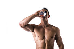 Muscular shirtless male bodybuilder drinking protein shake from blender. Isolated on white, looking up Royalty Free Stock Image