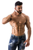 Muscular shirtless male model doing call me gesture. Handsome muscular shirtless male model doing call me gesture, isolated on white background stock photo
