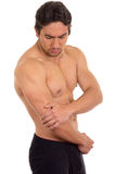 Muscular shirtless man with elbow pain Stock Photo