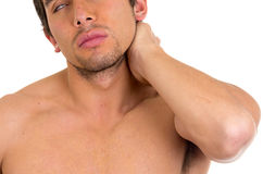 Muscular shirtless man with neck pain. Isolated on white Stock Photography