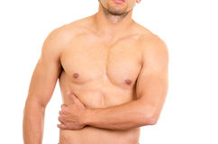 Muscular shirtless man with right abdomen pain. Isolated on white royalty free stock photo