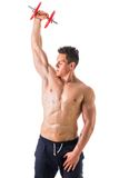 Muscular shirtless young man exercising triceps Royalty Free Stock Photos