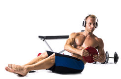 Muscular shirtless young man exercising with weights isolated Stock Photo