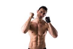 Muscular shirtless young man with handcuffs and leather glove Stock Image