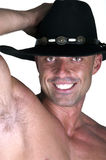 Muscular smiling cowboy. On white background Royalty Free Stock Images