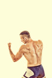 Muscular sports guy boxing ready to strike Royalty Free Stock Photos