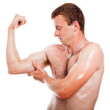 Muscular sports man checking biceps Stock Image
