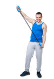 Muscular sportsman with expanders Royalty Free Stock Image