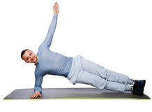Muscular sportsman practicing yoga on a mat Stock Image