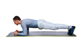 Muscular sportsman practicing yoga on a mat stock images