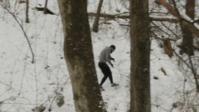 Young muscular sportsman runs among trees over the hills in the forest stock video