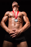 Muscular sportsmen with medal on his chest Royalty Free Stock Image
