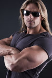 Muscular strong man stock photography