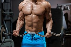 Mans body with barbell Royalty Free Stock Photography