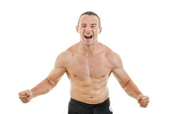 Muscular strong man fighter excited to win showing tighten muscl Stock Photos