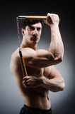 The muscular strong man with nunchucks Royalty Free Stock Images