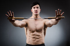 Free Muscular Strong Man With Nunchucks Stock Photos - 59451473